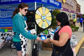 the-great-american-milk-drive_somerville-ma--dairy-farmer-greets-a-customer