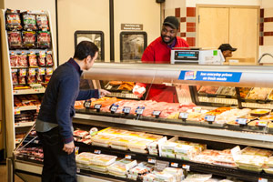 Employee Helping Customer